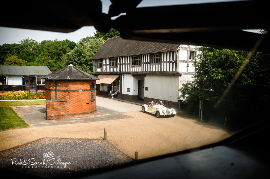 bride arrives in morgan wedding car at avoncroft museum