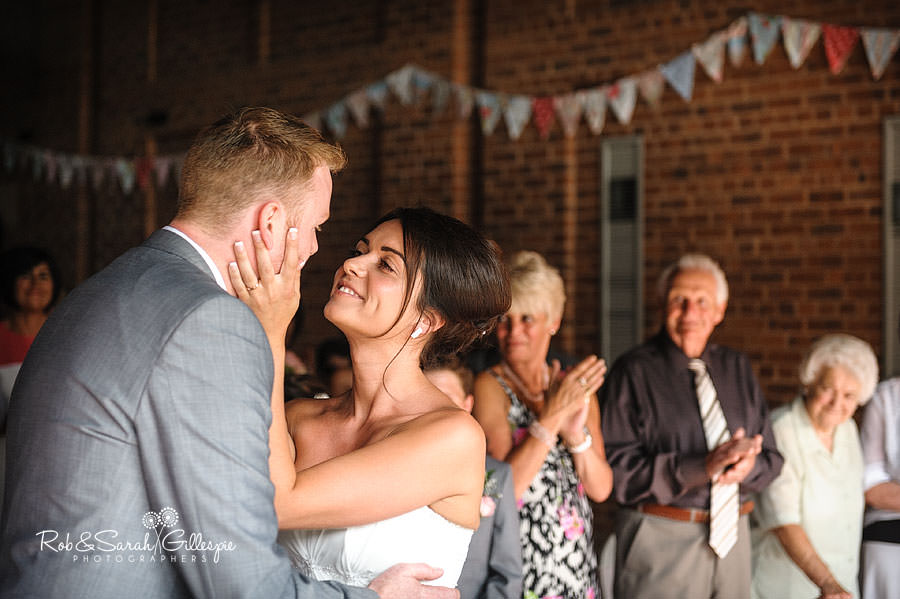bride and groom kiss during civil wedding at avoncroft museum