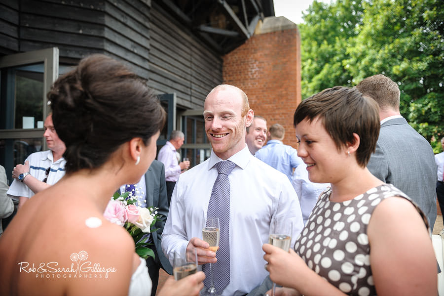 bride with guests after avoncroft museum wedding