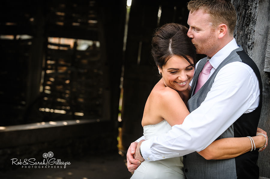 couple outside barn after wedding