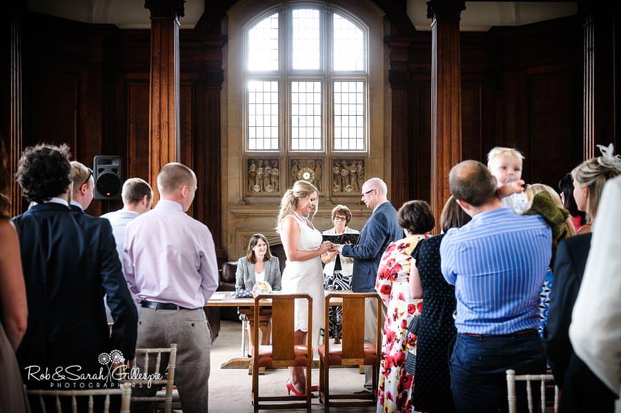 ring exchange during civil wedding at malvern college library