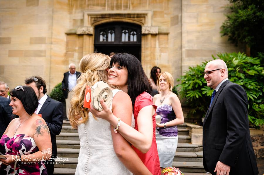 bride hugged by wedding guest