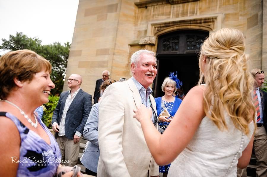 bride congratulated by wedding guests
