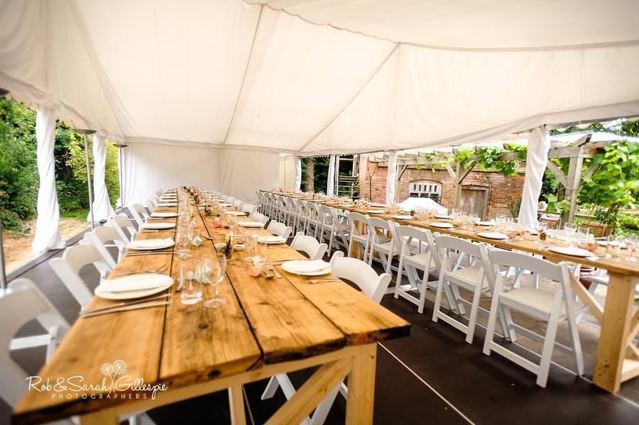 garden wedding reception tables in marquee