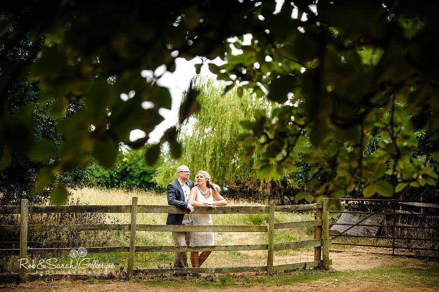 bride and groom relaxing in garden