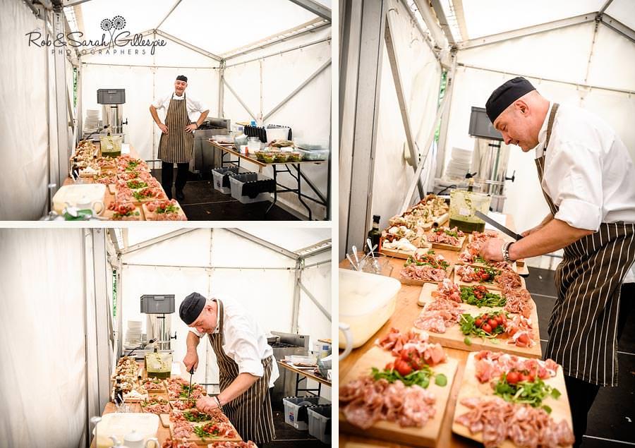 chef preparing wedding food in marquee