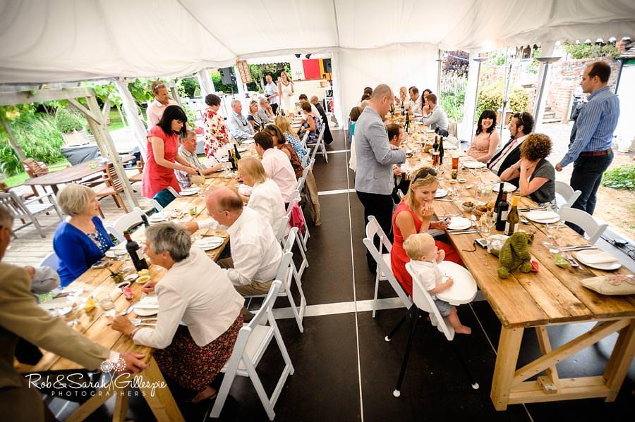 guests enjoying wedding breakfast in marquee