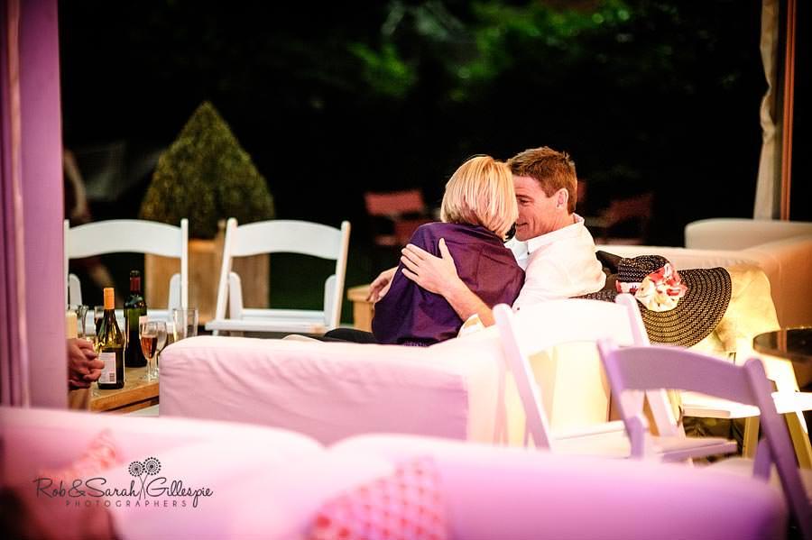 guests relax at summer garden wedding reception