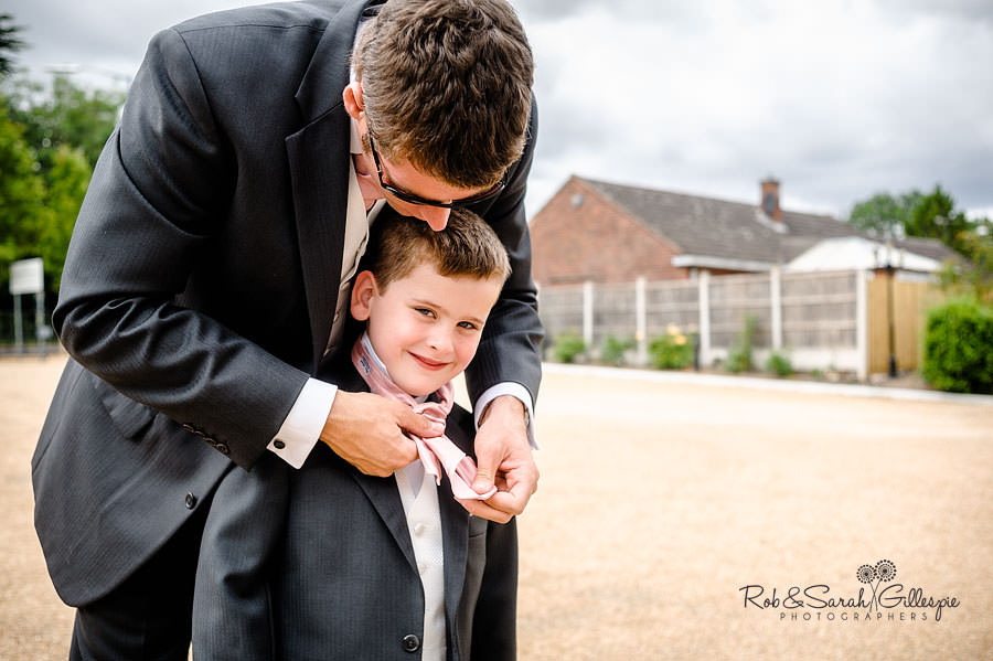 pageboy having tie fixed