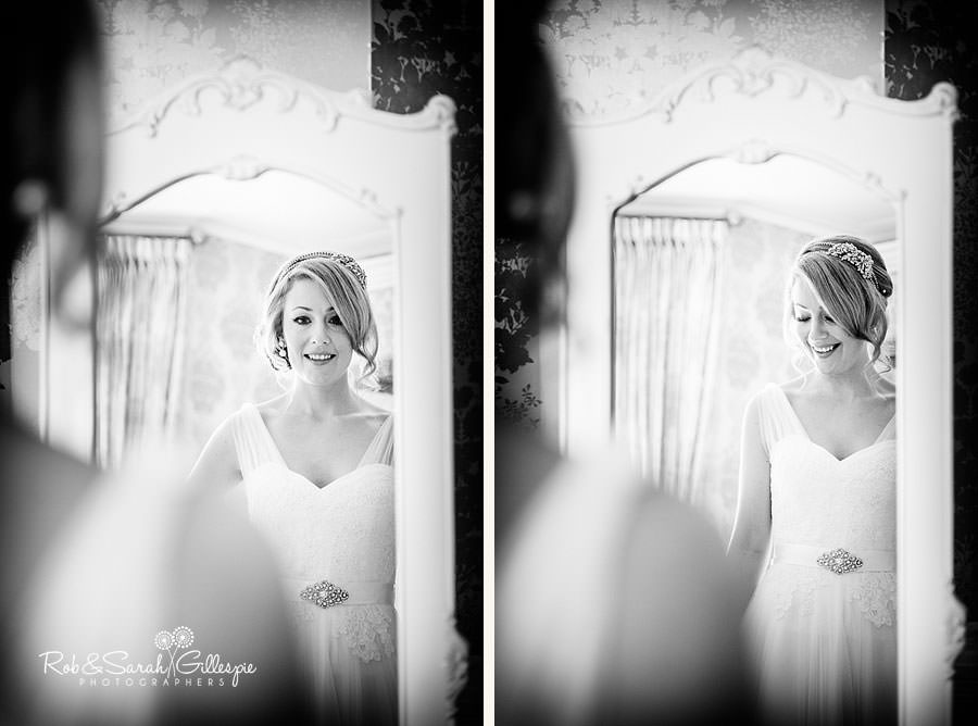 bride checks wedding dress in mirror