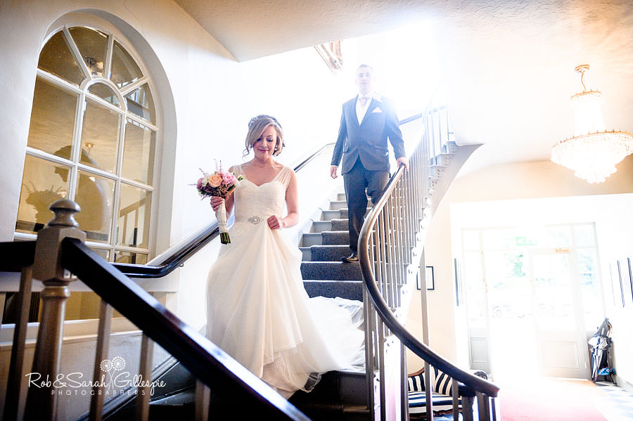bride walking down stairway