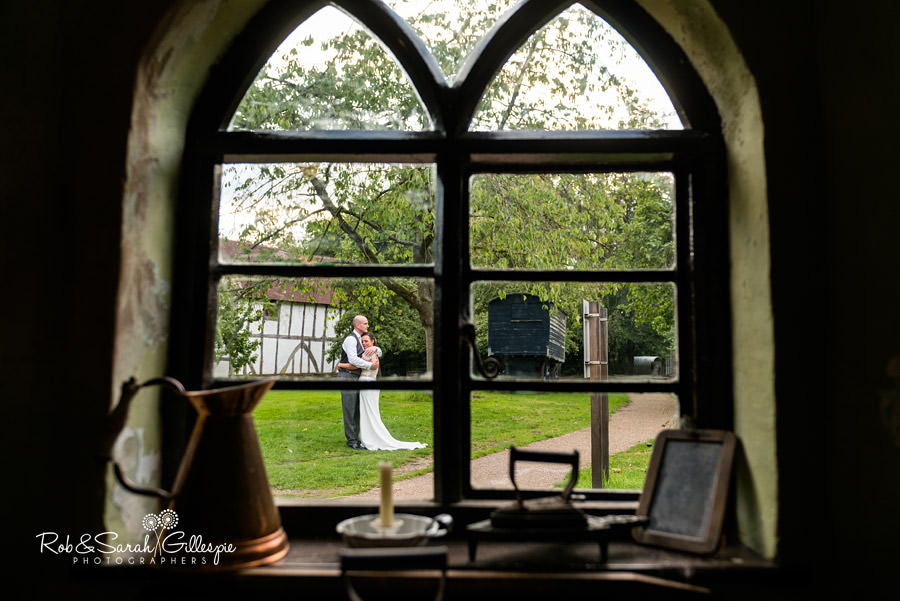 View of bride and groom through Toll House window at Avoncroft Museum