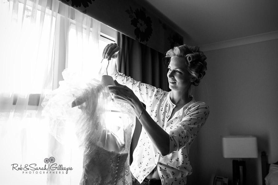 bride inspecting wedding dress
