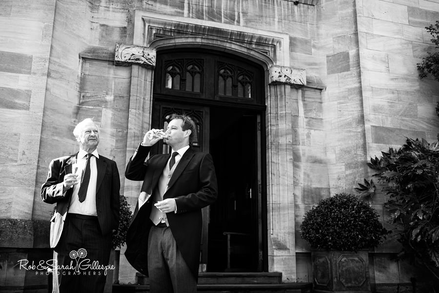 Groom and friend share a drink at Malvern College
