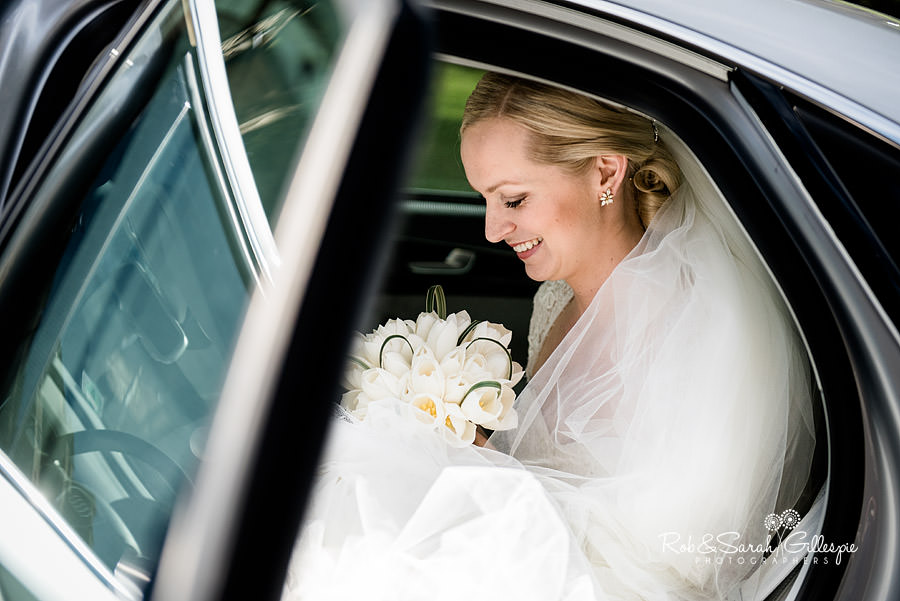 Beautiful bride gets waits in car before wedding