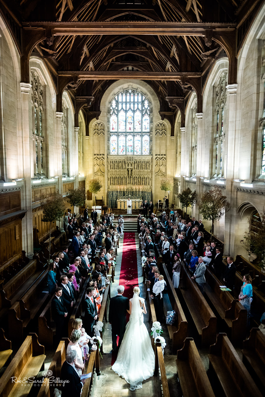 Wide angle image of bride walking up the aisle at Malvern College Chapel