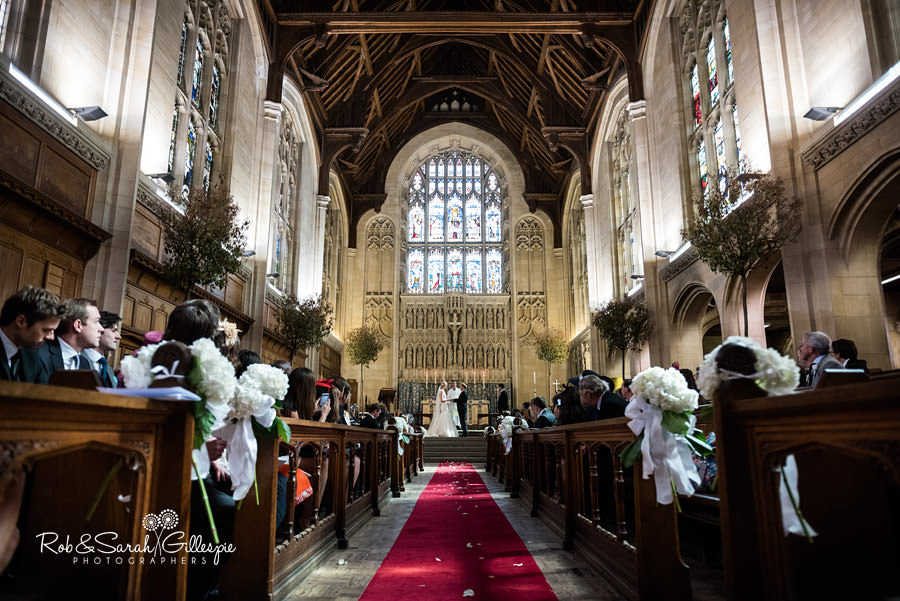 Wide angle dramatic image inside Malvern College chapel during wedding