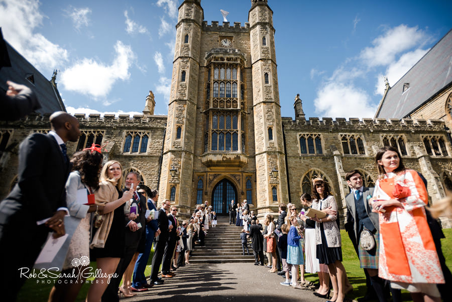 Wedding guests line up to throw confetti at Malvern College