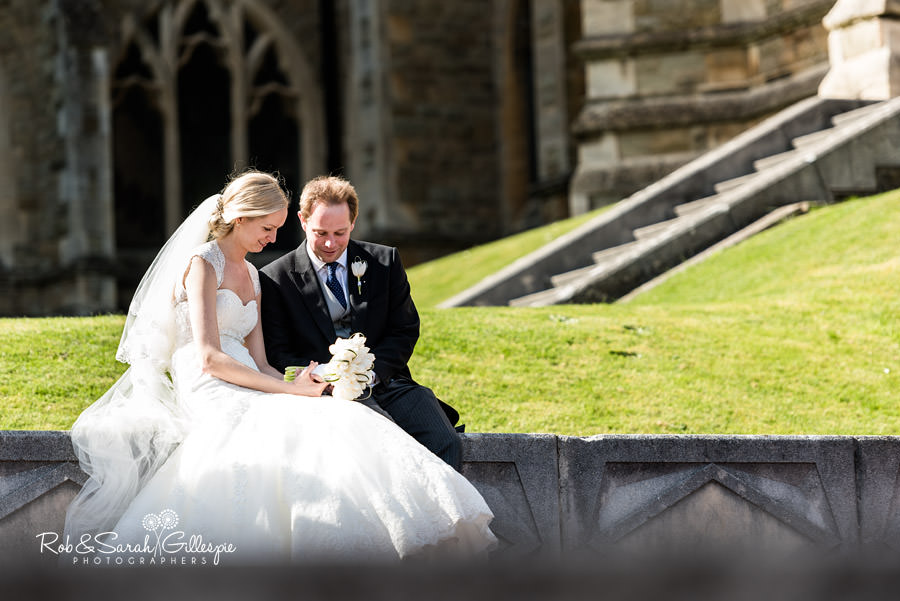 Bride and groom talk together at Malvern College