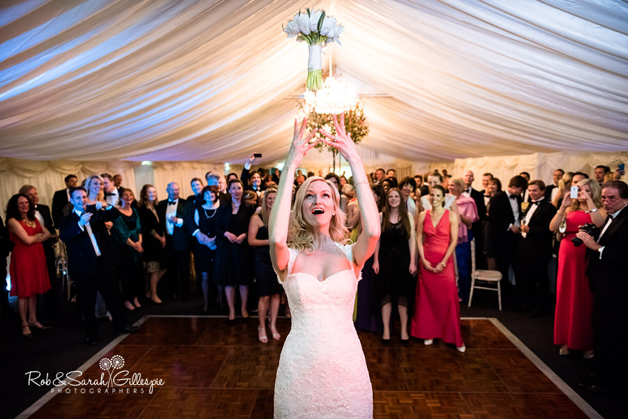 Bride throws bouquet in Gryphon Room at Malvern College