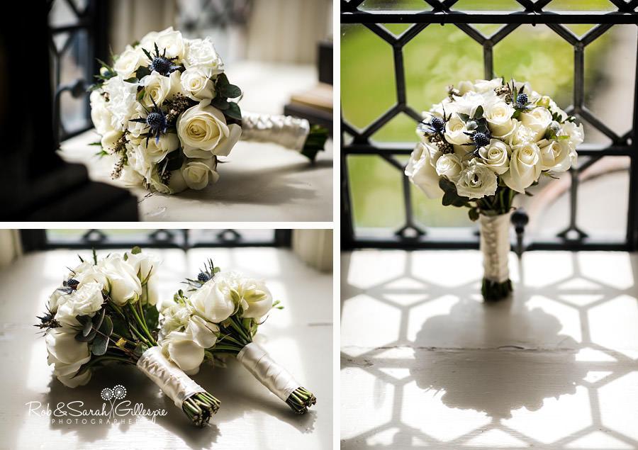 Wedding flowers in window in Coombe Abbey hotel room