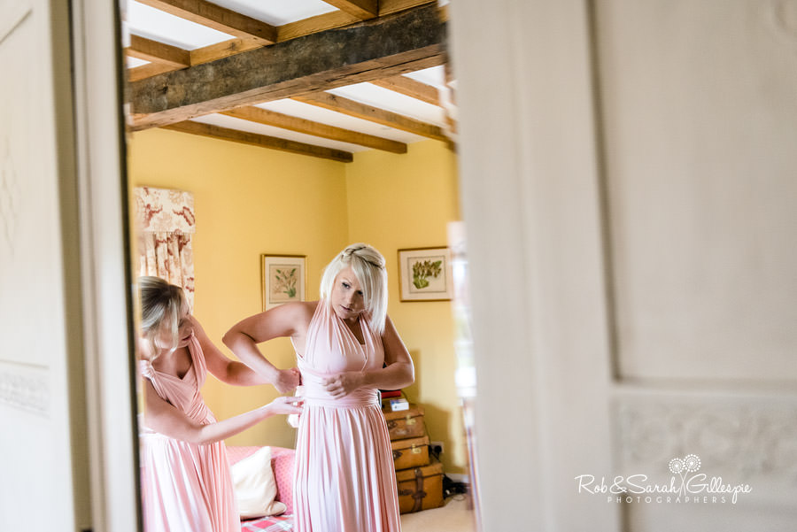 Bridesmaids preparing for wedding in Delbury Hall Coachhouse room