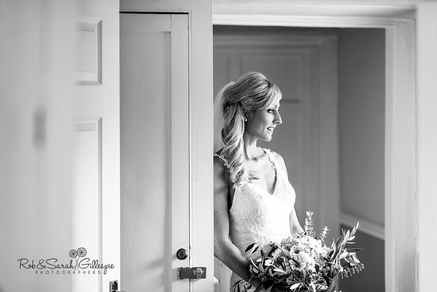 Pensive bride portrait in window light at Delbury Hall
