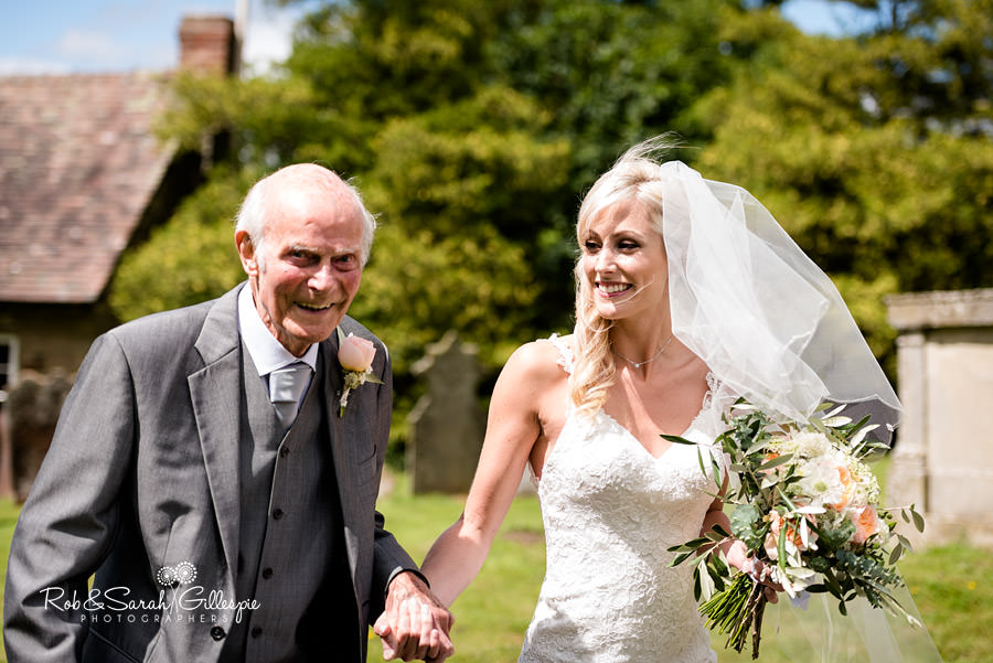 Bride and grandfather arrive at wedding in Diddlebury