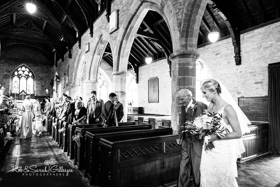 Bride enters church for wedding at St Peters Diddlebury