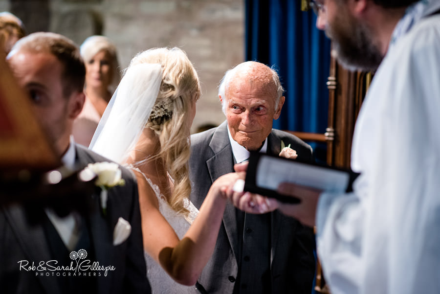 Grandfather gives bride away in church service wedding
