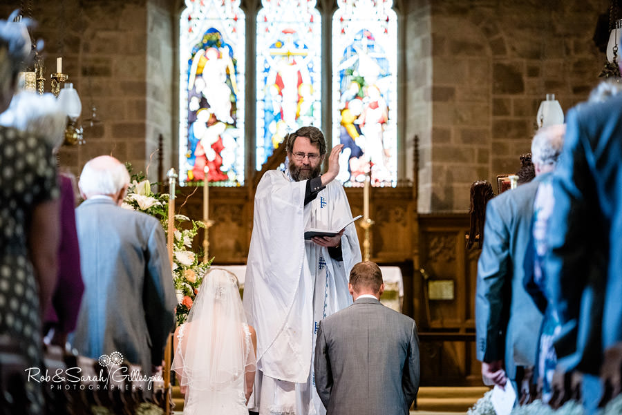 Rev John Beesley blesses couple during wedding service in Diddlebury