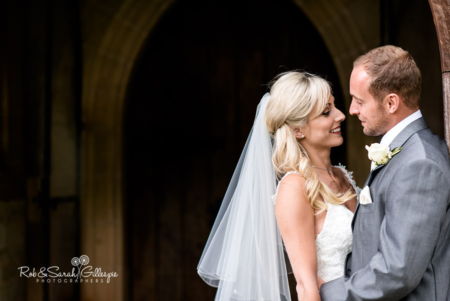 Bride and groom share a quiet moment at St Peters Church Diddlebury