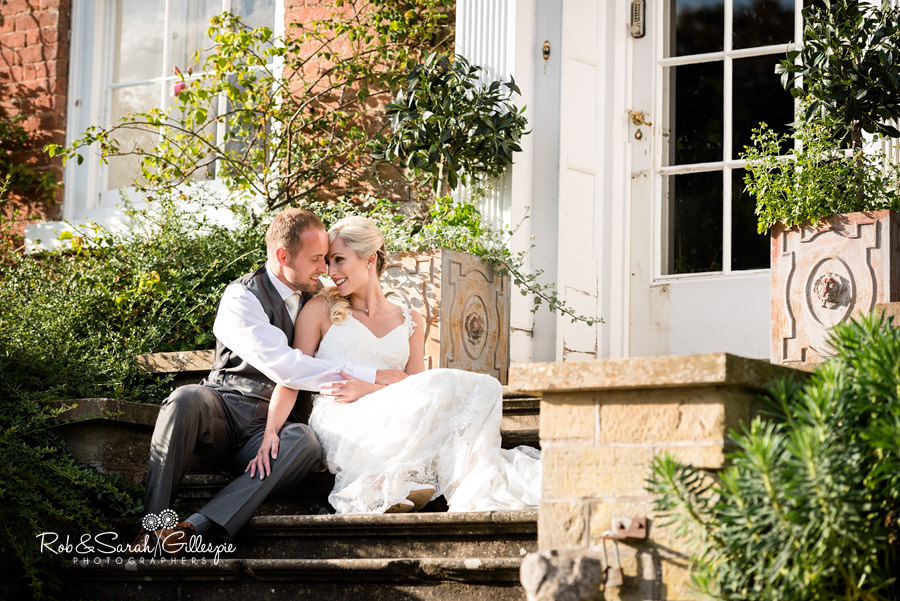 Bride adn groom enjoying a quiet moment at Delbury Hall in sunshine