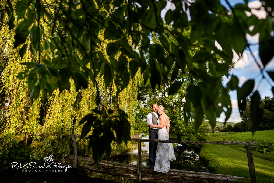 Bride and groom in Delbury Hall grounds relaxing in the evening