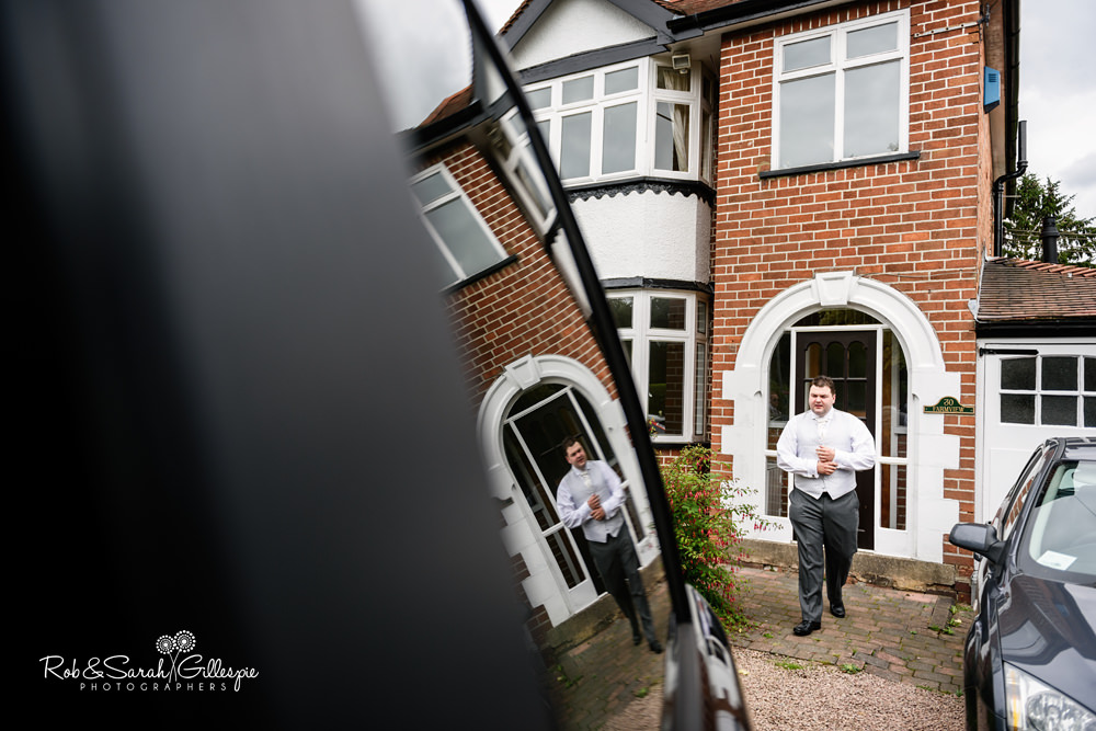 Groom prepares for wedding at before for Gorcott Hall