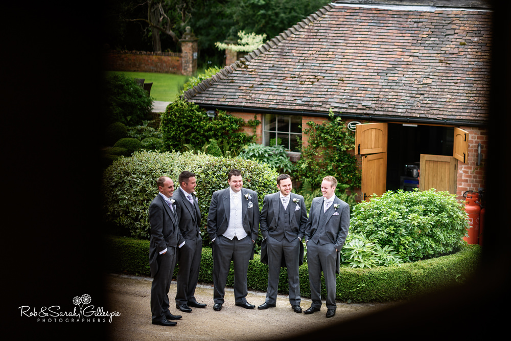 Groom and ushers pose for group photo at Gorcott Hall