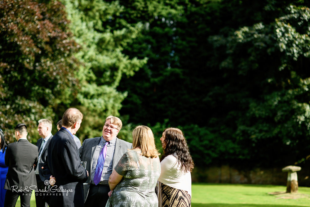 Wedding guests relax at Gorcott Hall wedding reception