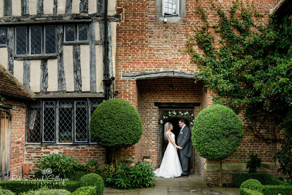 Bride and groom in doorway at Gorcott Hall