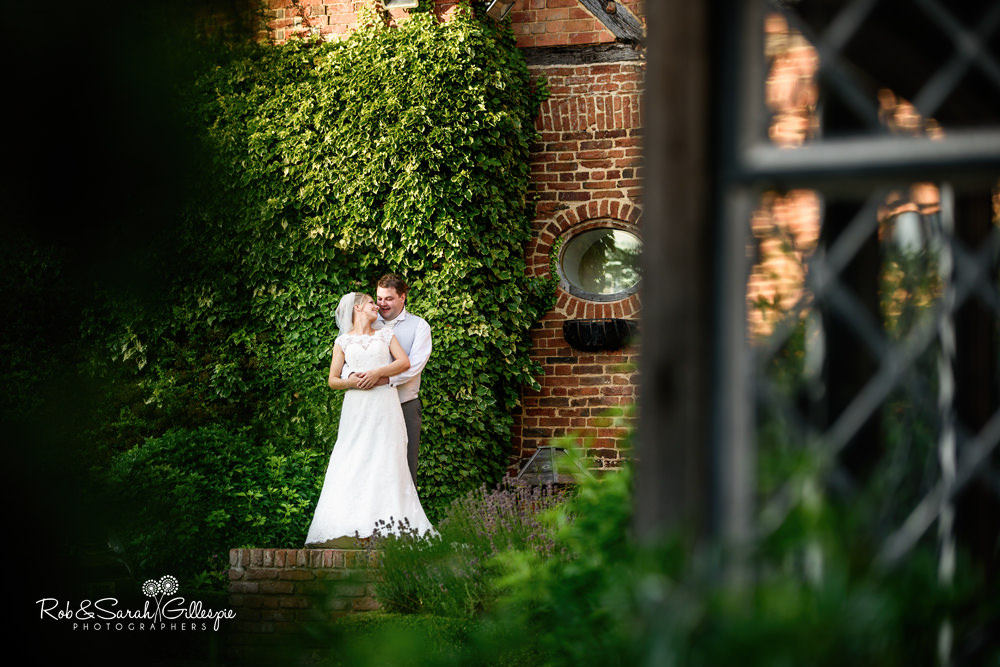 Bride and groom at Gorcott Hall - relaxing in the grounds