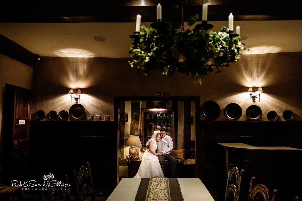 Bride and groom at Gorcott Hall - relaxing inside the house