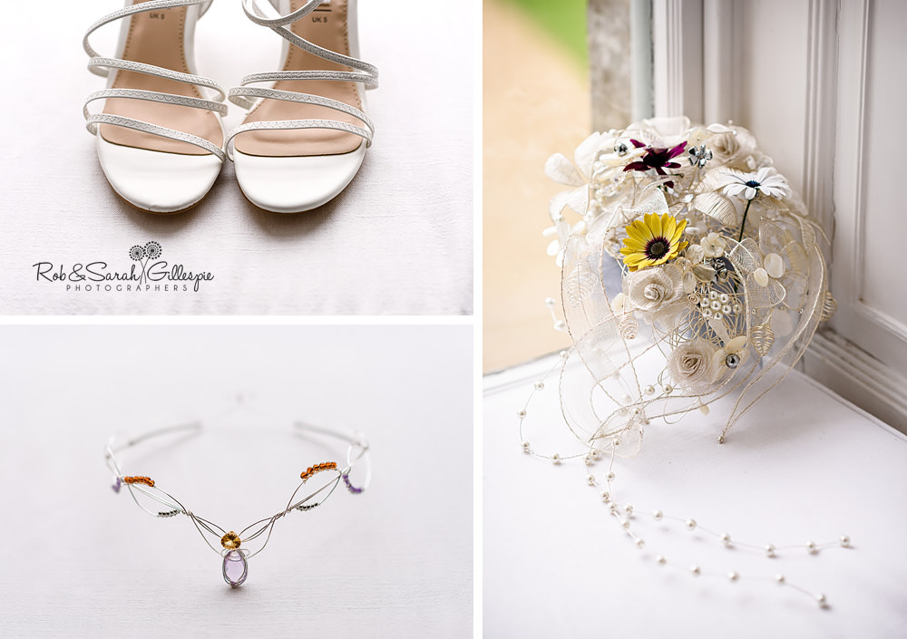 Bridal shoes, tiara and ornate bouquet in window light