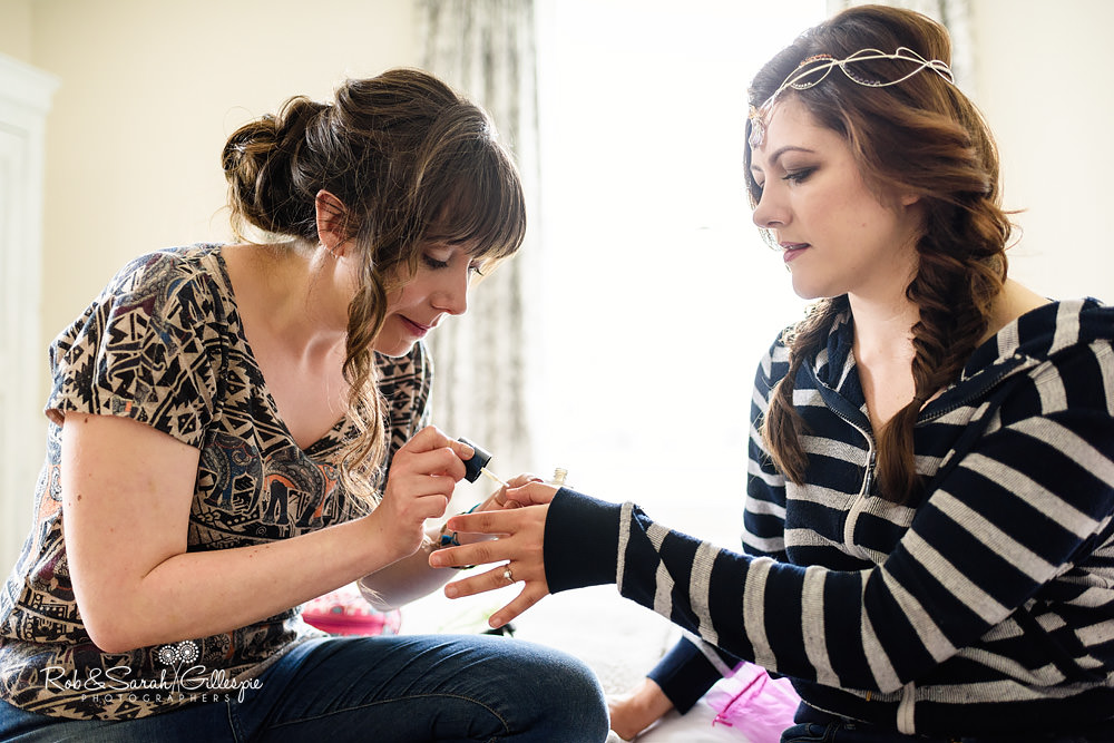 Bride having nails painted by bridesmaid at the Matara Centre