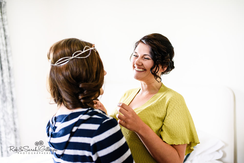 Bride and bridesmaid sharing a laugh