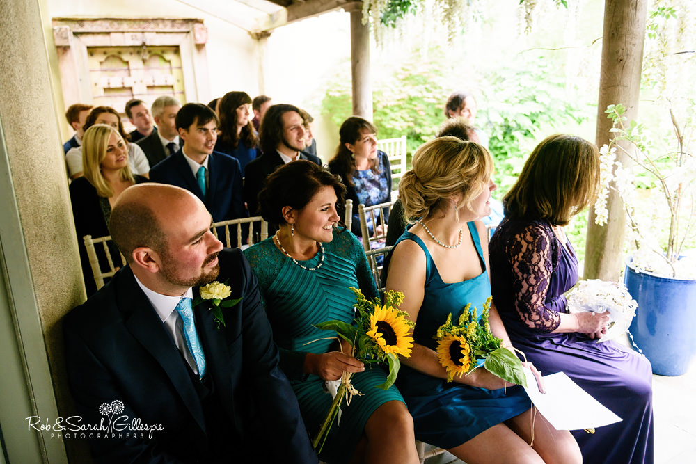 Wedding guests watch ceremony at the Matara Centre