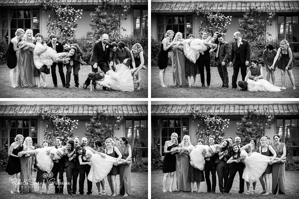 Brides, bridesmaids and ushers group photo at same-sex wedding