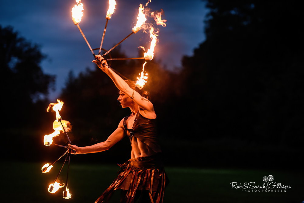 Acrobat fire performance at same-sex wedding