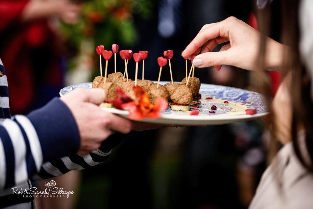Wedding guests enjoying drinks reception at Delbury Hall wedding