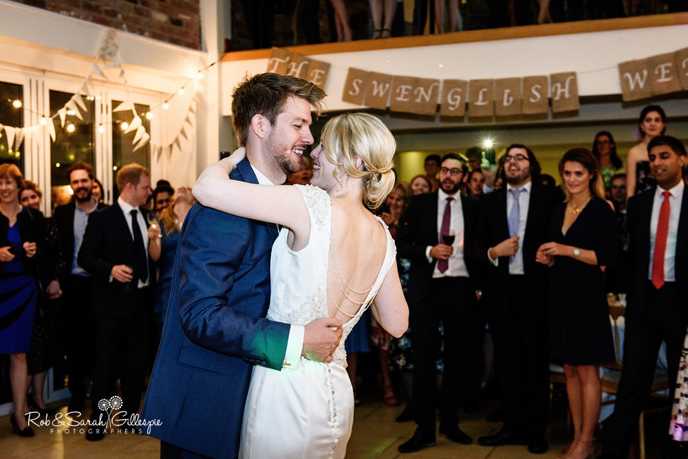 Dancing at Delbury Hall Coach House wedding