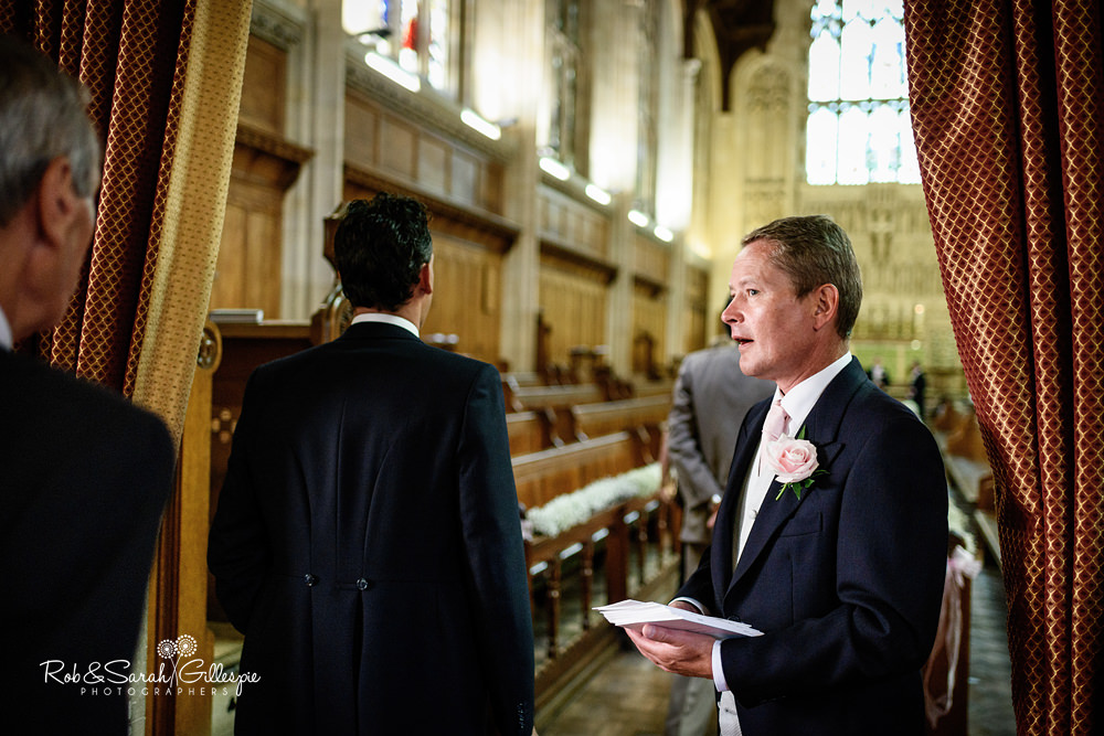 Groom and ushers welcoming wedding guests at Malvern College chapel