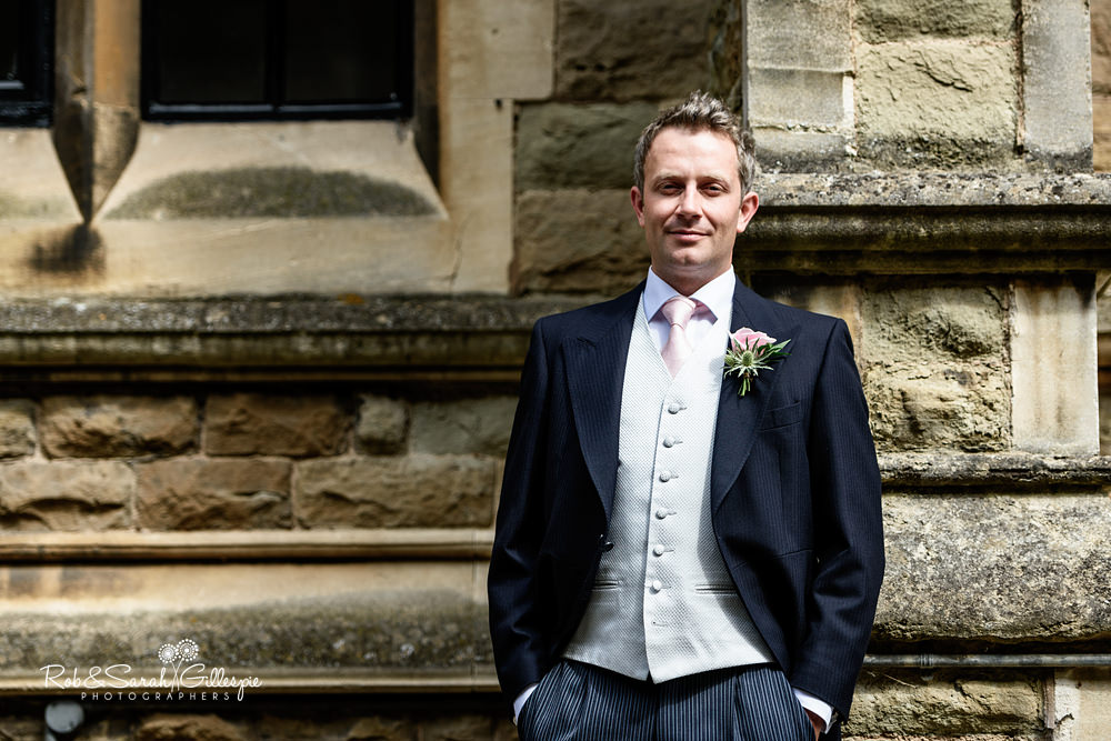 Portrait of groom in strong light at Malvern College chapel